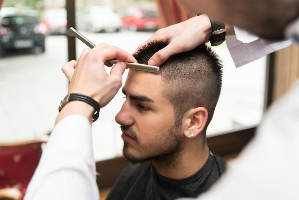 a hairdresser giving a man a haircut